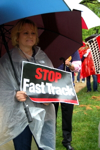 Unionists Ignore Downpour, Fight Fast Track