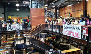Students Swarm Rockville REI to Protest North Face Sweatshops